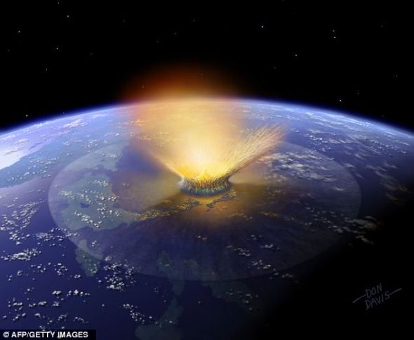 电脑生成的模拟图像,展示了一颗小行星撞击墨西哥尤卡坦半岛的景象。据信,此次撞击导致恐龙走向灭绝